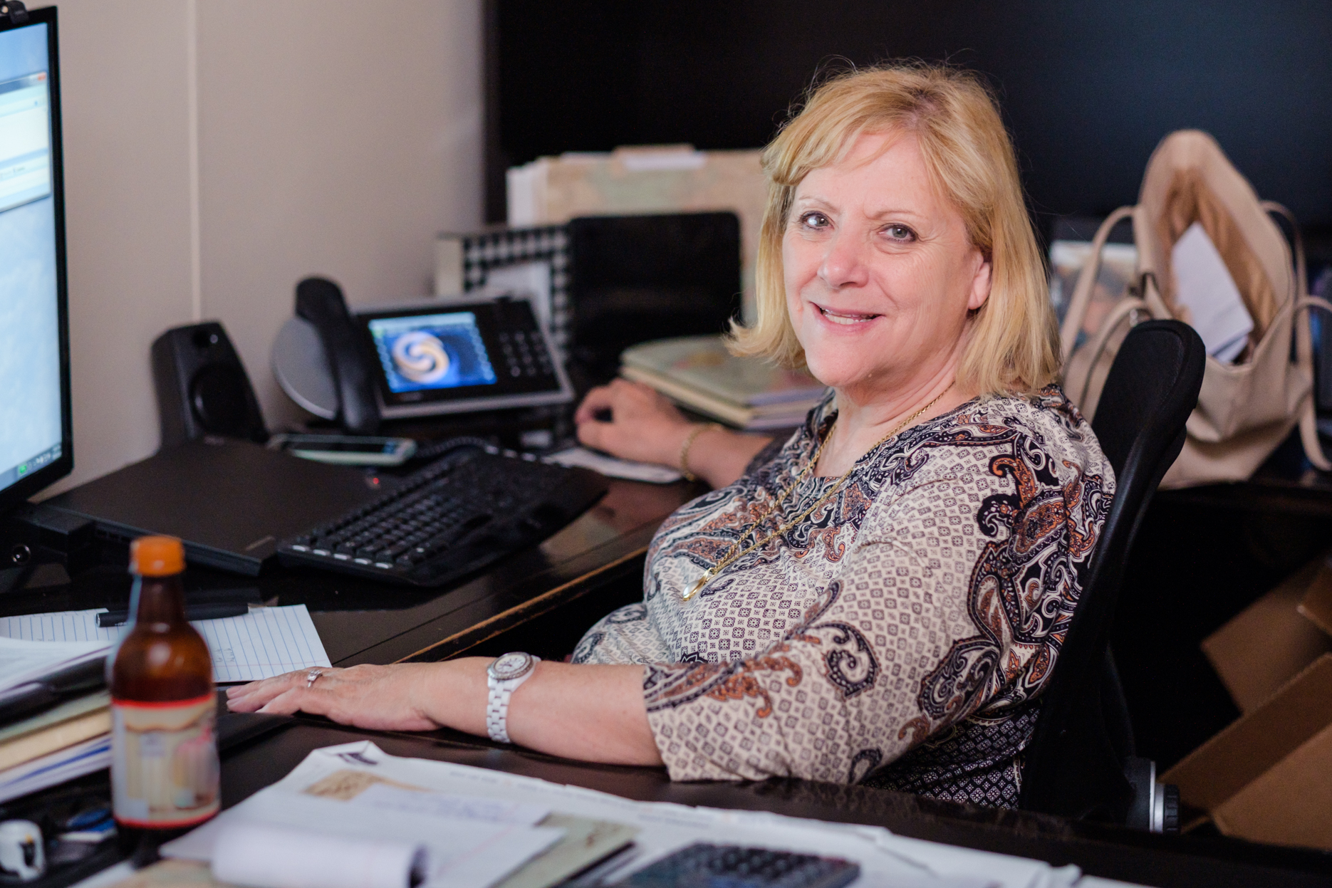 Maintex President Linda Silverman works at her desk.